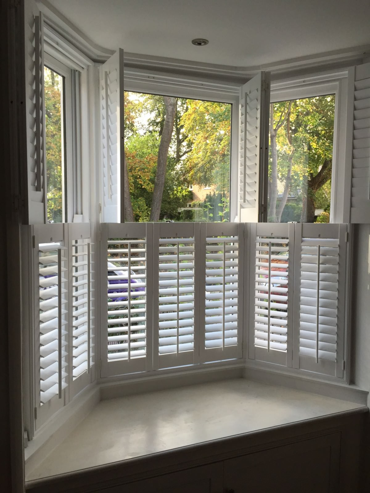 Bay window shutters fitted in netley abbey shuttersouth for Window shutters