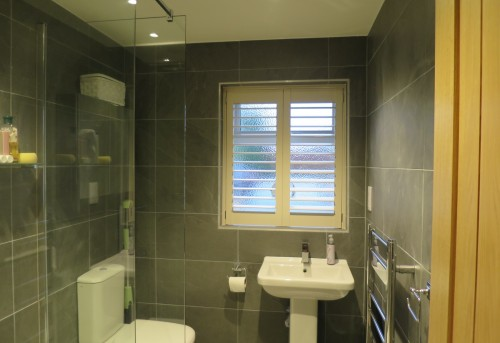 Tracked Plantation Bathroom Shutters Fitted in Bishops Waltham - Shuttersouth