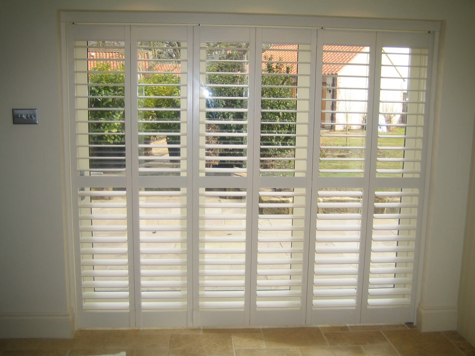 5 Benefits Of Tracked Shutters For Bifold Doors Shuttersouth
