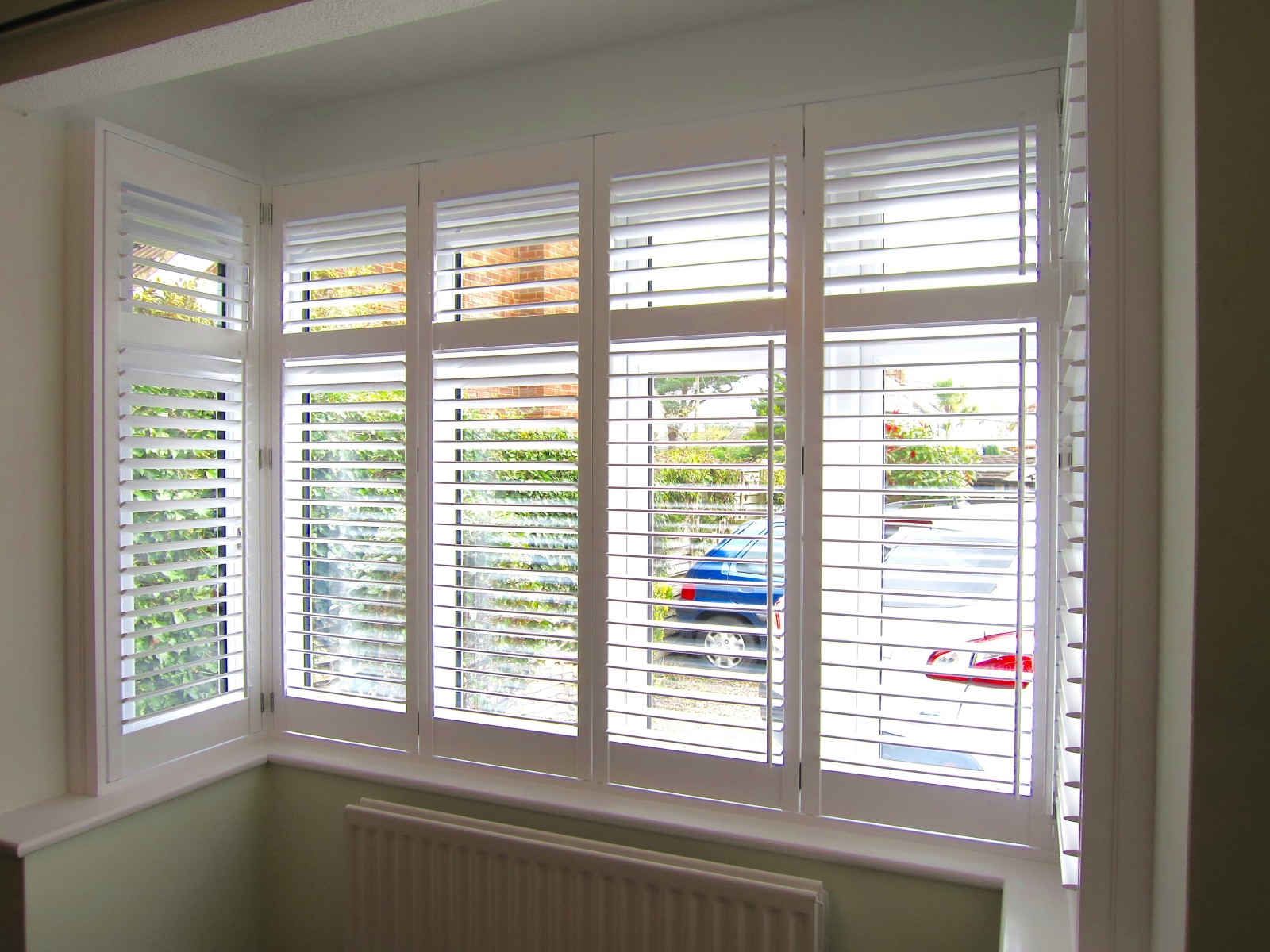Bay window plantation shutters fitted in new forest for Window shutters